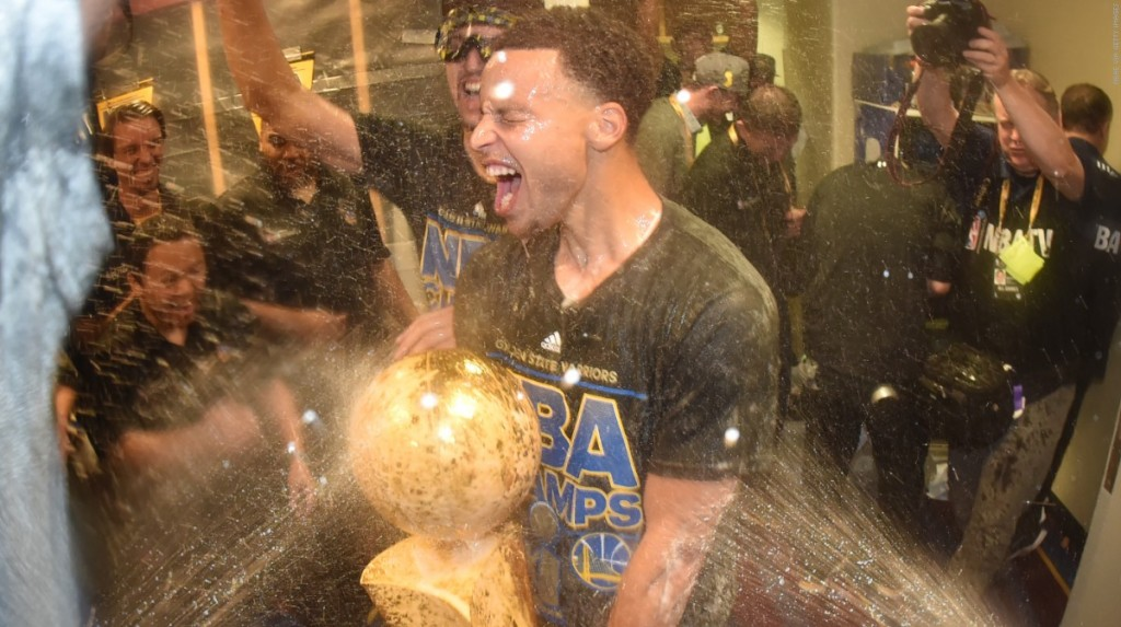 150617011351-stephen-curry-locker-room-celebration-champagne-061615.1200x672