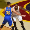 CLEVELAND, OH - JUNE 8:  LeBron James #23 of the Cleveland Cavaliers handles the ball against Stephen Curry #30 of the Golden State Warriors in Game Three of the 2016 NBA Finals on June 8, 2016 at Quicken Loans Arena in Cleveland, Ohio. NOTE TO USER: User expressly acknowledges and agrees that, by downloading and/or using this Photograph, user is consenting to the terms and conditions of the Getty Images License Agreement. Mandatory Copyright Notice: Copyright 2016 NBAE (Photo by Jesse D. Garrabrant/NBAE via Getty Images)