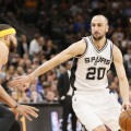 May 22, 2017; San Antonio, TX, USA; San Antonio Spurs shooting guard Manu Ginobili (20) drives to the basket as Golden State Warriors center JaVale McGee (1) defends during the first half in game four of the Western conference finals of the NBA Playoffs at AT&T Center. Mandatory Credit: Soobum Im-USA TODAY Sports