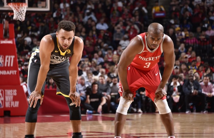 HOUSTON, TX - JANUARY 20: Stephen Curry #30 of the Golden State Warriors and Chris Paul #3 of the Houston Rockets looks on during the game on January 20, 2018 at the Toyota Center in Houston, Texas. NOTE TO USER: User expressly acknowledges and agrees that, by downloading and or using this photograph, User is consenting to the terms and conditions of the Getty Images License Agreement. Mandatory Copyright Notice: Copyright 2018 NBAE (Photo by Bill Baptist/NBAE via Getty Images)